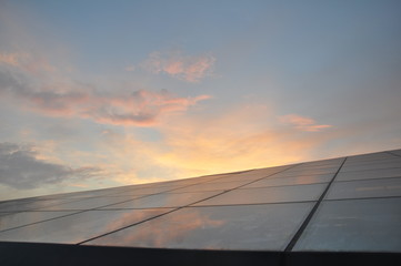 Glass structure and the sunset on the background