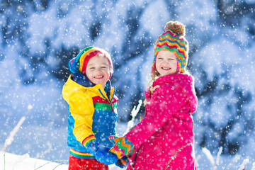 Children playing in snowy winter park