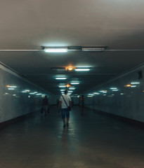 Dark tunnel with lights, people go, the prospect