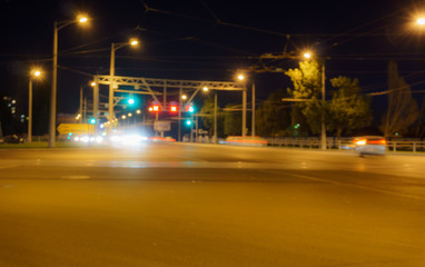 Night intersection, cars, blurred photo