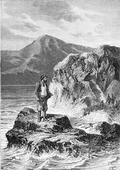 Man standing on a rock on the sea coast.
