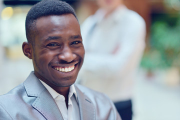 Portrait of smiling young black man in hall
