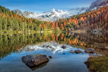 Colourful mountain landscape in autumn with water reflection