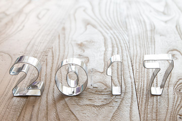 New Year 2017 on a wood background