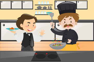 Chef and waiter in the kitchen