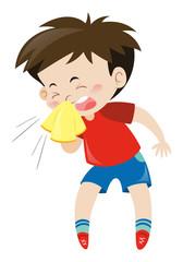 Boy in red shirt sneezing