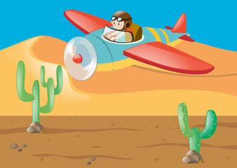 Pilot flying over the desert ground