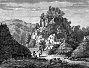 Village amidst rocky formations