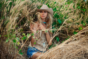 Cowgirl outdoors. Countryside style