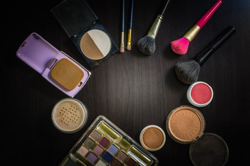 Top view cosmetics Makeup Placed on a wooden table.Cosmetics Makeup It is something that has been very popular in the lives of women in modern times
