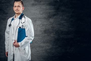 Studio portrait of young medical doctor.