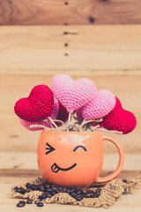 smile coffee cup with heart on wood background, happy love drink coffee concept.