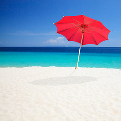 Red Beach Umbrellas with sky background