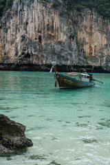Boat trip to tropical islands. View on beautiful turquoise sea with boat and rocks