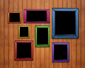 Colorful wicker wooden picture frame. on wood planks wall