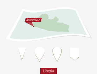 Curved paper map of Liberia with capital Monrovia on Gray Background. Four different Map pin set. Vector Illustration.
