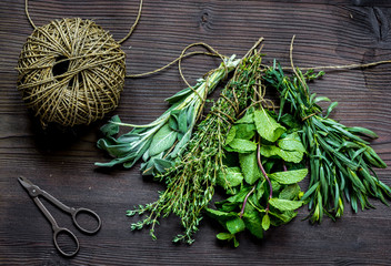 sage and thyme, mint, estragon on wooden background top view