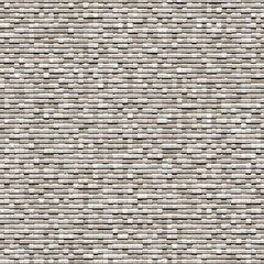 Gray background of small bricks
