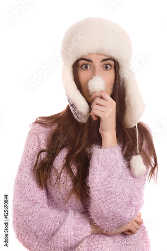 e370eb8e0f6 fun girl in winter hat making nose isolated on white background ...