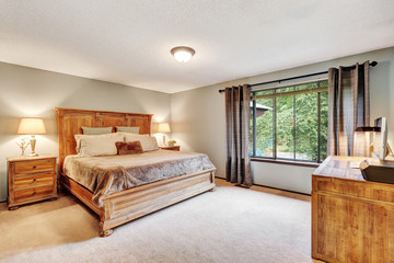 American Bedroom interior with queen size bed and wooden desk
