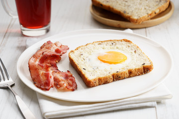egg in a hole and crispy bacon