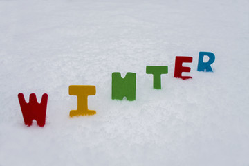 colorful words winter on snow background