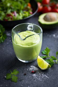 avocado salad dressing. Creamy avocado sauce in glass.
