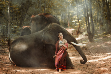 Beautiful woman and elephant with Thai culture traditional ,vintage style