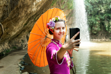 Beautiful woman with Vietnam culture traditional dress, Ao dai and holding straw hat.
