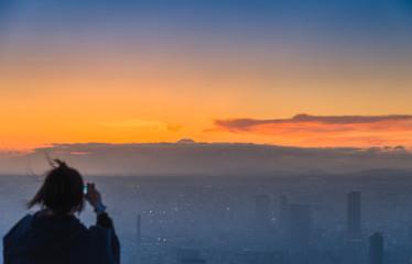 Blur Tourist take photo Fuji mountain in the evening scene
