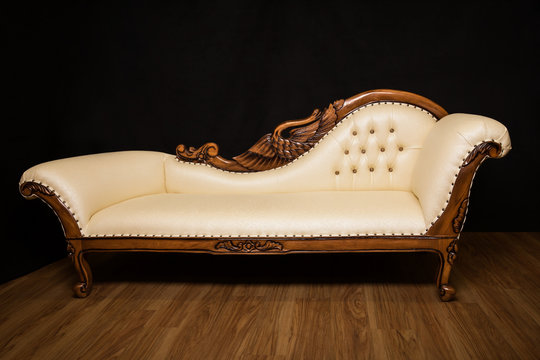 Antique white sofa with ornaments