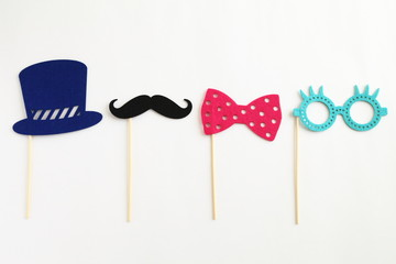 Photo booth colorful props for party - glasses, mustache, hat, ribbon on white background