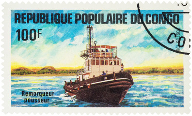 Pusher tug on postage stamp