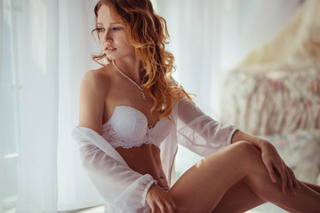 beautiful and gentle bride in underwear in the morning