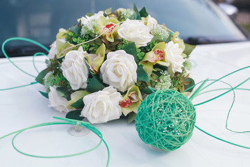 Wedding decoration on the luxury white car