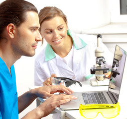 two researchers in the laboratory
