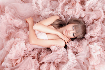 creative portrait of a fashion woman in gorgeous long pink dress