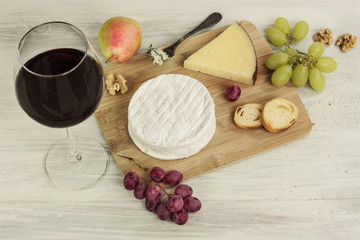 Red wine, cheese, grapes, nuts, with copyspace
