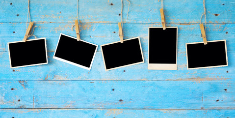 old photographs,empty photo frames on wooden grungy background