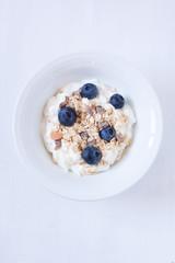 muesli with blueberry and yogurt on a white background