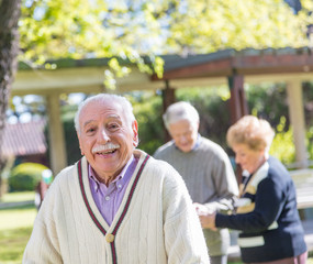 Elder people relaxing outdoor in rehab hospital garden