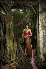 Asian woman wearing dress traditional Thai costume ,beautiful women thai in the past.