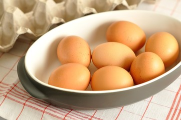 Raw eggs in the grey pan