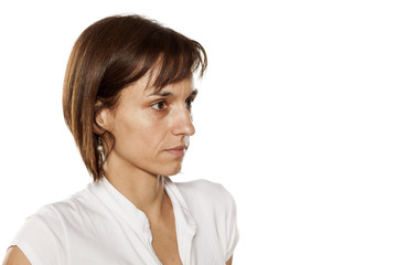 Portrait of skinny middle-aged woman with no makeup
