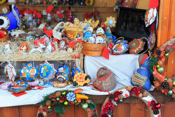 Colorful close up details of christmas fair market. Knitted balls decorations for sales.