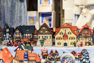 Colorful close up details of christmas fair market. Houses decorations for sales.