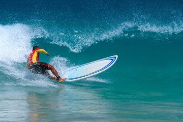 Surfer enjoys the waves in Kata beach, Phuket. Thailand.