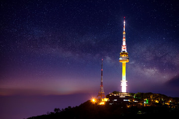Seoul tower with Milky way at night.Namsan Mountain in korea Wall mural
