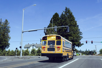 School Bus Stopped at Railroad Crossing
