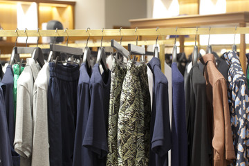 Row of fashion clothing on hangers